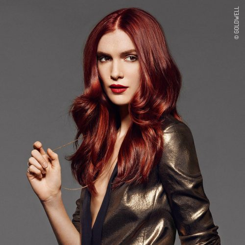The Glowing Mahogany Service! Red hair colour for women at Element Hair Waterloo